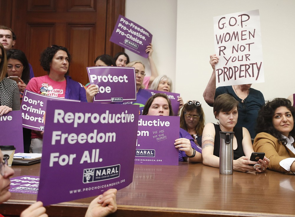 """File-Supporters crowd a meeting room before a roundtable discussion at the Georgia State Capitol in Atlanta on Thursday, May 16, 2019, to discuss abortion bans in Georgia and across the country. A federal judge is permanently blocking Georgia's 2019 """"heartbeat"""" abortion law, finding that it violates the U.S. Constitution. U.S. District Judge Steve Jones ruled against the state Monday, July 13, 2020, in a lawsuit filed by abortion providers and an advocacy group. (Bob Andres/Atlanta Journal-Constitution via AP, File)"""