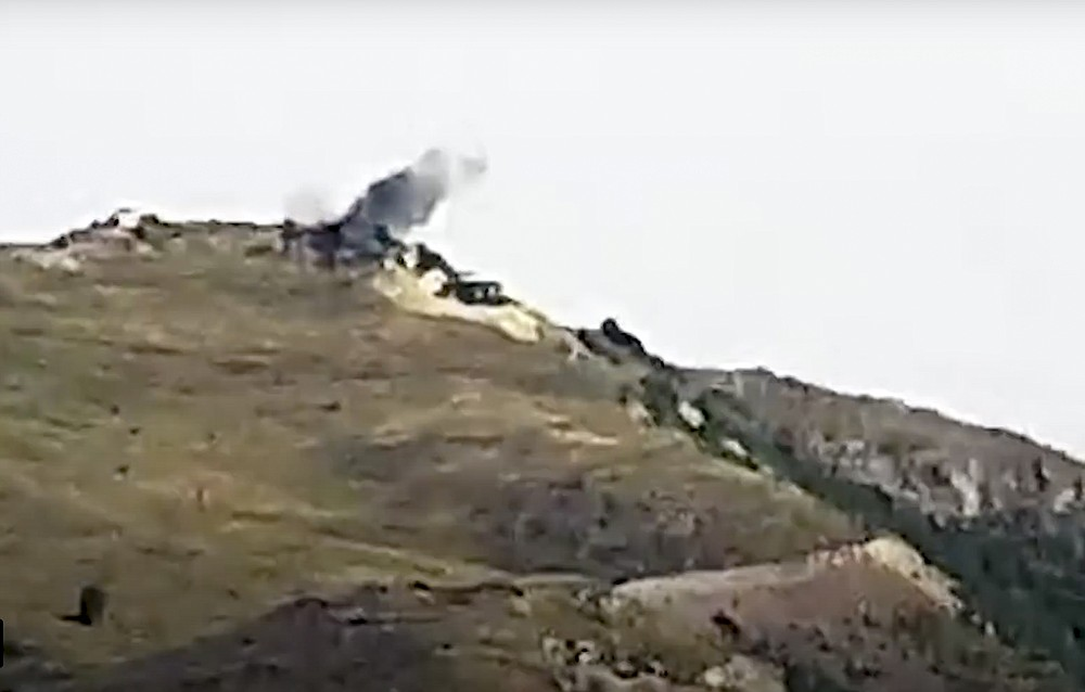 This photo taken from a footage distributed by Armenian Defense Ministry Press Service on July 14, 2020, shows the smoke from the explosions of the shelling by Armenian forces in the Tovuz region of Azerbaijan. Skirmishes on the volatile Armenia-Azerbaijan border escalated Tuesday, marking the most serious outbreak of hostilities between the neighbors since the fighting in 2016. (Armenian Defense Ministry Press Service via AP)