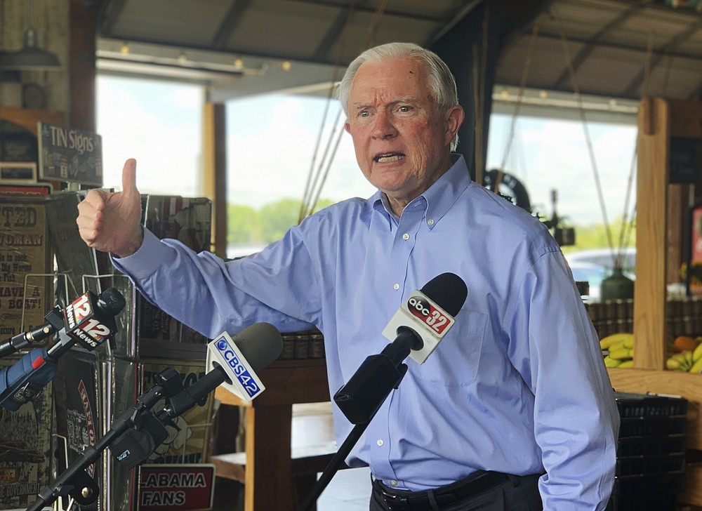 Former U.S. Attorney General Jeff Sessions speaks to reporters during a campaign stop at Sweet Creek restaurant and farmers market, south of Montgomery, Ala., Monday, July 6, 2020. Sessions faces former Auburn University football Coach Tommy Tuberville in the July 14 Republican runoff. Sessions held the seat for 20 years before resigning to become President Donald Trump's first attorney general. (AP Photo/Kim Chandler)
