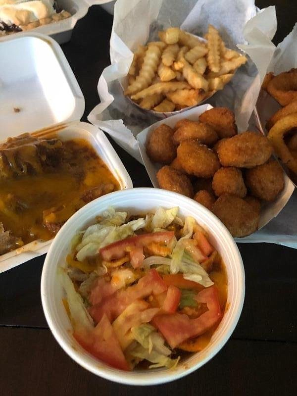 Frito Pie (clockwise from bottom), tamales, french fries, onion rings and corn nuggets are among the selections from Wink's Dairy Bar.