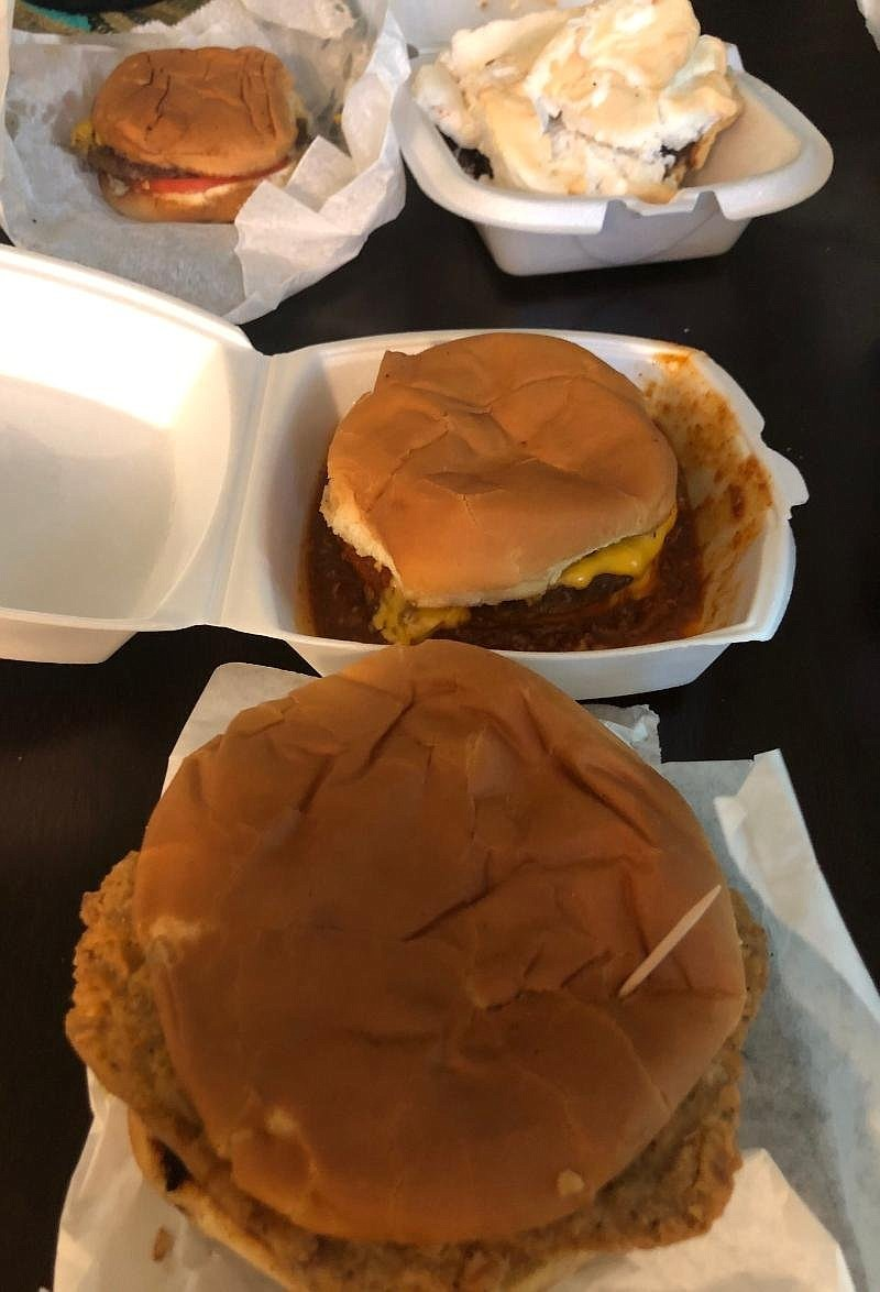A Steak Sandwich (foreground), Chili Cheeseburger, Cheeseburger and a slice of Chocolate Pie were ordered from Wink's Dairy Bar.