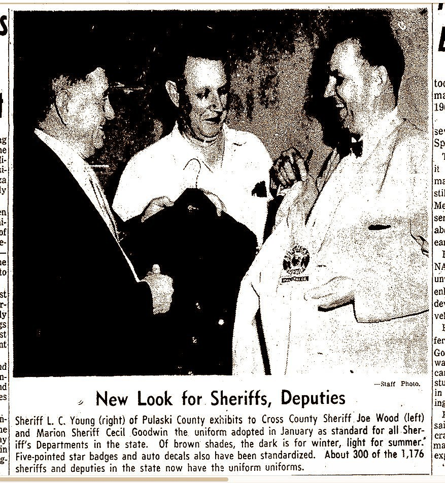 Crittenden County Sheriff Cecil V. Goodwin (center) compares new uniforms with those of Pulaski County Sheriff L.C. Young (right) and Cross County Sheriff Joe Wood in a photo of a clipping from the Arkansas Gazette in1960. Goodwin served from 1943-64 and was in charge when Isadore Banks was lynched. He refused to call it a lynching, though, and a short investigation ended with no charges filed. His widow, Maggie Sue Goodwin, died in 1999, leaving her church a $7 million bequest.   (Arkansas Democrat-Gazette)