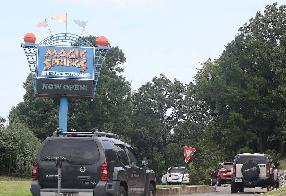 Motorists head into Magic Springs Theme and Water Park on Wednesday. - Photo by Richard Rasmussen of The Sentinel-Record