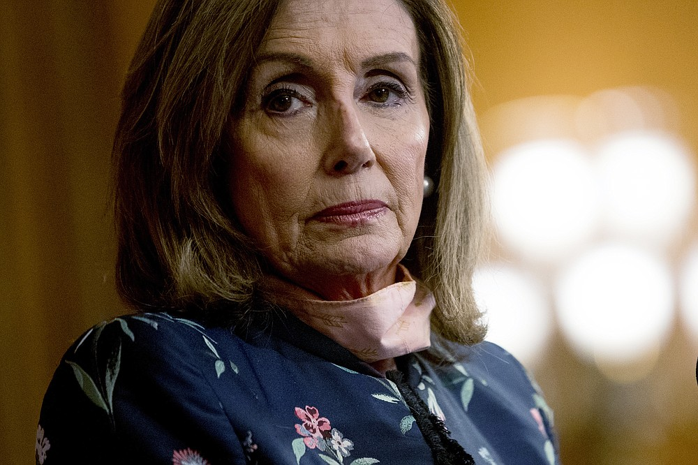 "House Speaker Nancy Pelosi of Calif., pauses during a news conference on Capitol Hill in Washington, Wednesday, July 15, 2020, to mark two months since House passage of ""The Heroes Act"" or the Health and Economic Recovery Omnibus Emergency Solutions Act. (AP Photo/Andrew Harnik)"