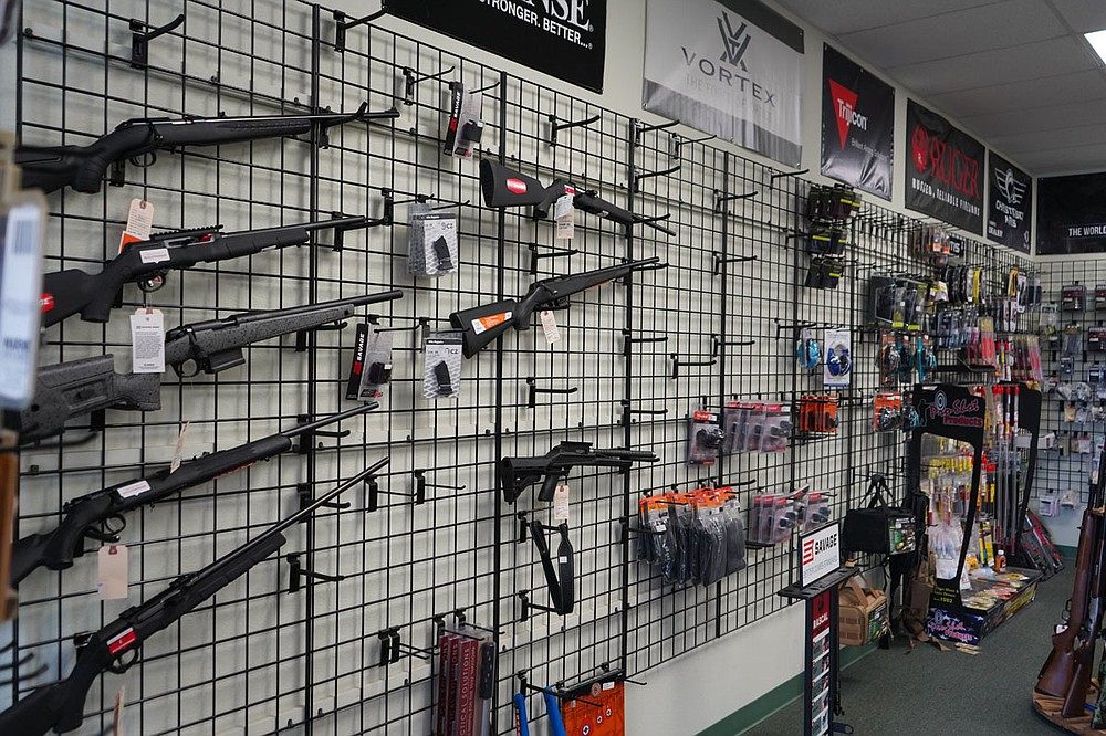 A half-empty gun rack at Arego's Wholesale Guns in shown on Friday. - Photo by Cassidy Kendall of The Sentinel-Record