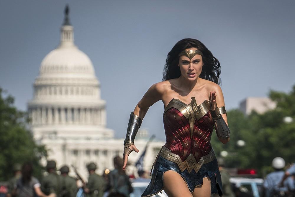 "Wonder Woman (Gal Gadot) makes a run for it in ""Wonder Woman 1984."""