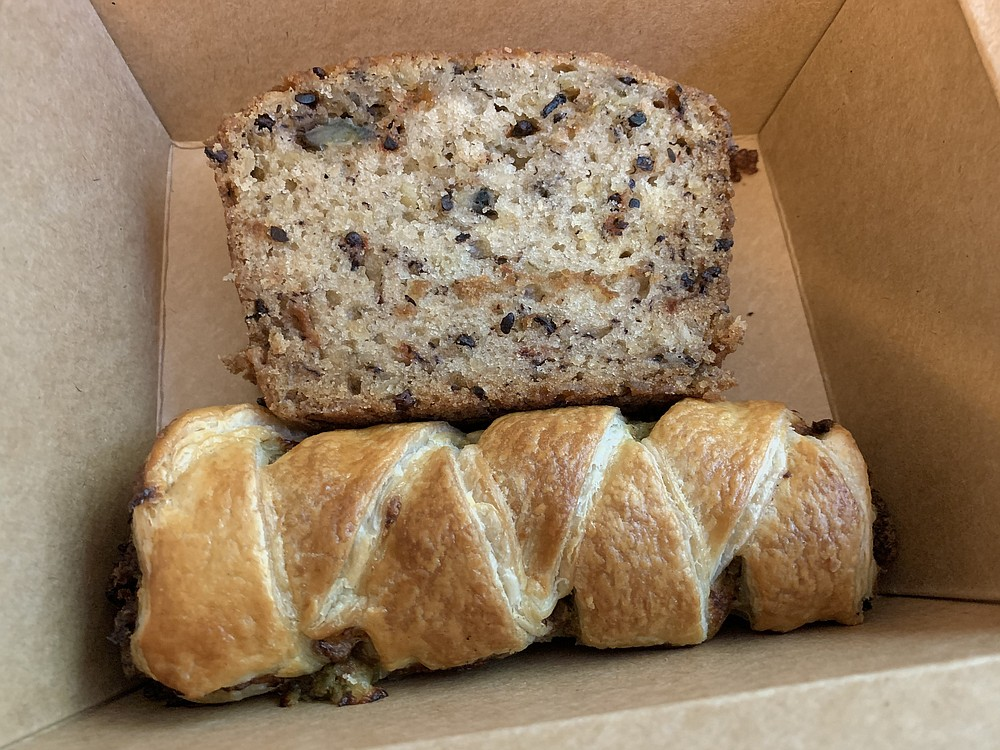 The banana bread with cocoa nibs (top) from Mylo Coffee Co. is supposedly vegan; the sausage roll isn't. (Arkansas Democrat-Gazette/Eric E. Harrison)