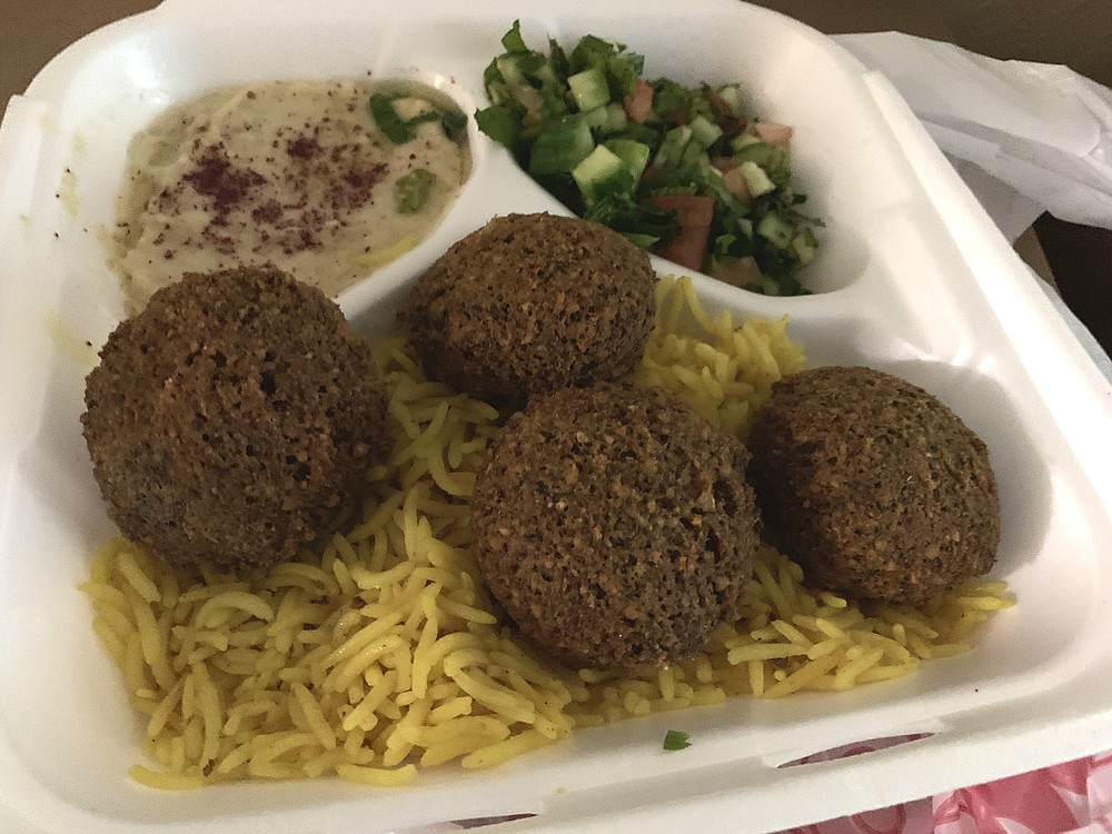 The Falafel Shawarma Plate from ZamZam doesn't actually come with any shawarma, but it does feature  four pieces of falafel with hummus and a tabbouleh-like salad on the side. (Arkansas Democrat-Gazette/Eric E. Harrison)