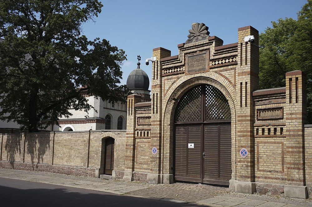 A star of David stands at the top behind the entrance of the synagogue in Halle, Germany, Monday, July 20, 2020. The trial of a heavily armed attacker who wanted to force his way into the synagogue begins on Tuesday, July 21, 2019 in Magdeburg. After not entering the synagogue, the man shot two passers-by.(AP Photo/Markus Schreiber)