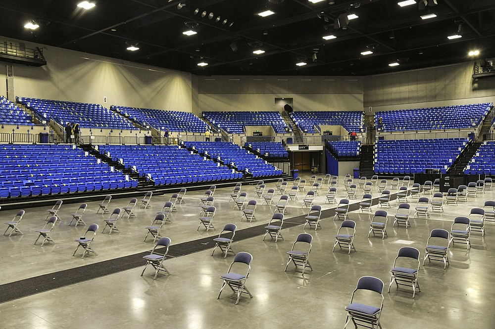 The floor of Bank OZK Arena is set up for a graduation ceremony in keeping with Arkansas Department of Health directives. - Photo by Grace Brown of The Sentinel-Record