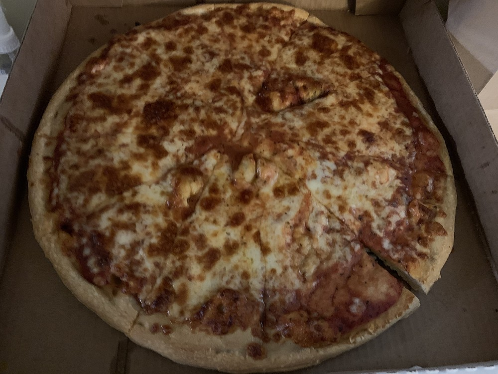 You can get a large cheese pizza at medium price on Monday's from Grady's on Little Rock's Rodney Parham Road. (Arkansas Democrat-Gazette/Eric E. Harrison)