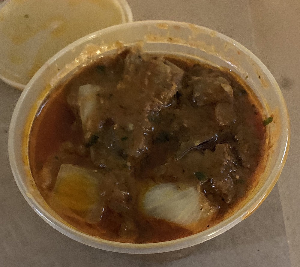 There's more Karahi Lamb than seemed to meet the eye in the round plastic to-go container from Taj Mahal. (Arkansas Democrat-Gazette/Eric E. Harrison)