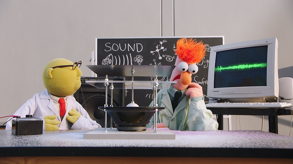"""Dr. Bunsen Honeydew (left) and his assistant, Beaker, conduct a series of vibrational experiments with the help of a lonely, outdated computer in an episode of """"Muppets Now"""" on Disney +."""