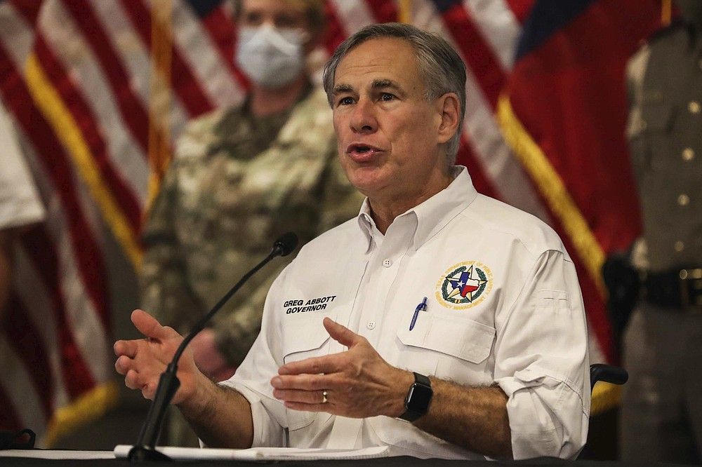 Gov. Greg Abbott provides an update on the state's ongoing response to Hurricane Hanna in Austin, Texas on Saturday, July 25, 2020. (Lola Gomez/Austin American-Statesman via AP)