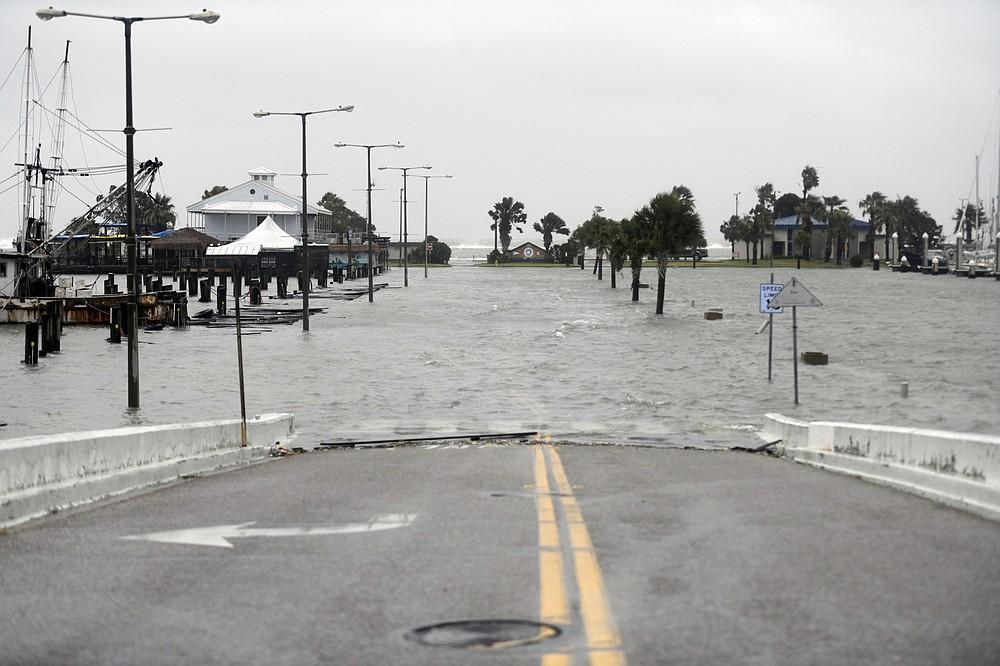 Peoples Street begins to flood during Hurricane Hanna, Saturday, July 25, 2020, in Corpus Christi, Texas. (Annie Rice/Corpus Christi Caller-Times via AP)