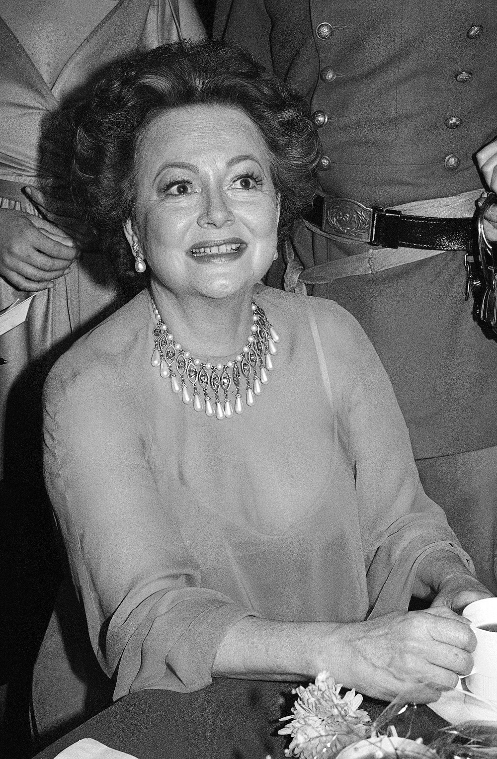 FILE - In this file photo dated Dec. 28, 1979, actress Olivia De Havilland at Hollywood dinner party. Olivia de Havilland, Oscar-winning actress has died, aged 104 in Paris,  publicist says Sunday July 26, 2020. (AP Photo/ Nick Ut, FILE)