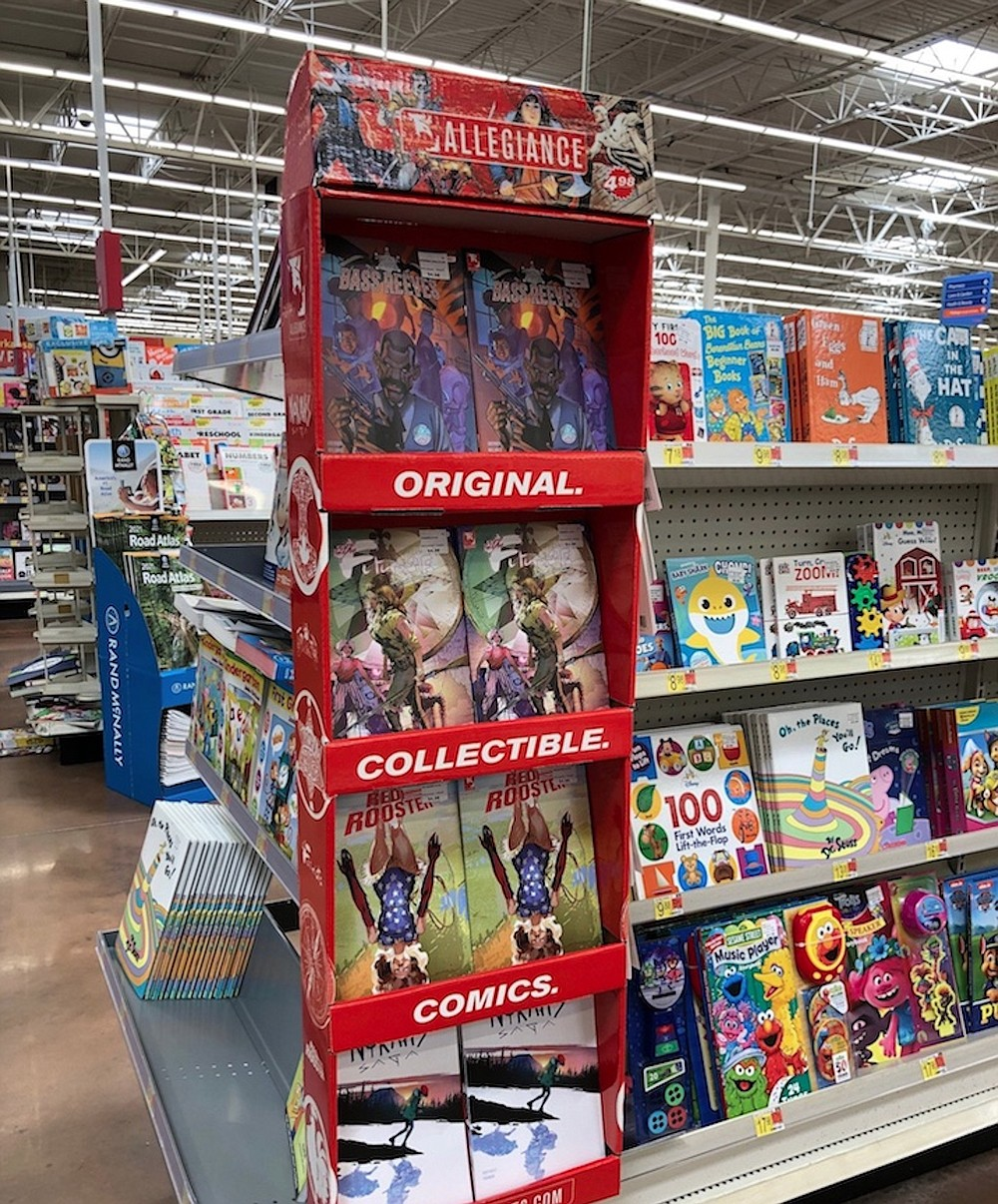 Copies of the latest issues of comic books from Allegiance Arts & Entertainment are on display at Walmart, 19301 Cantrell Road, Little Rock. (Arkansas Democrat-Gazette/Sean Clancy)