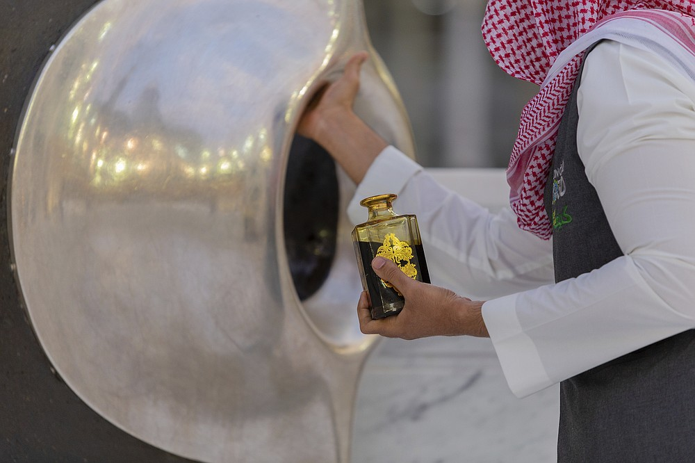 The Black Stone located on the Kaaba's eastern corner is prepared before pilgrims start their circumambulation of the the square structure in the Great Mosque, toward which believers turn when praying, in Mecca, Saudi Arabia, late Monday, July 27, 2020. Anywhere from 1,000 to 10,000 pilgrims will be allowed to perform the annual hajj pilgrimage this year due to the coronavirus pandemic. (Saudi Ministry of Media via AP)