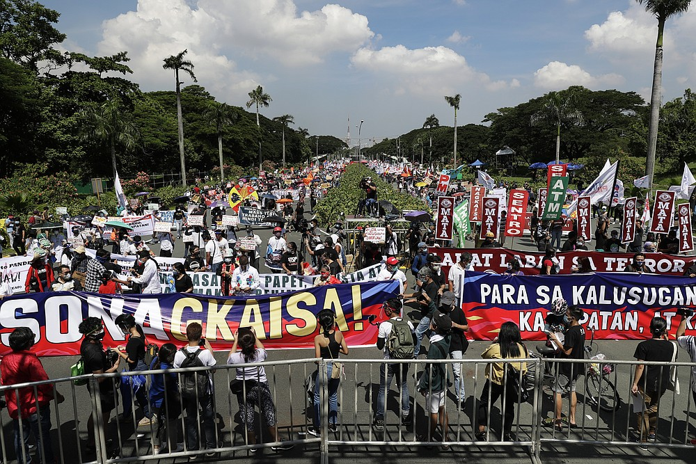Protesters hold slogans during a rally at the University of the Philippines against the State of the Nation Address (SONA) by Philippine President Rodrigo Duterte on Monday, July 27, 2020 in Manila, Philippines. Hundreds of protesters marched, staged motorcades and held the rally against a new anti-terror law and other issues Monday in the Philippine capital despite police threats of arrests ahead of the president's annual state of the nation speech. (AP Photo/Aaron Favila)