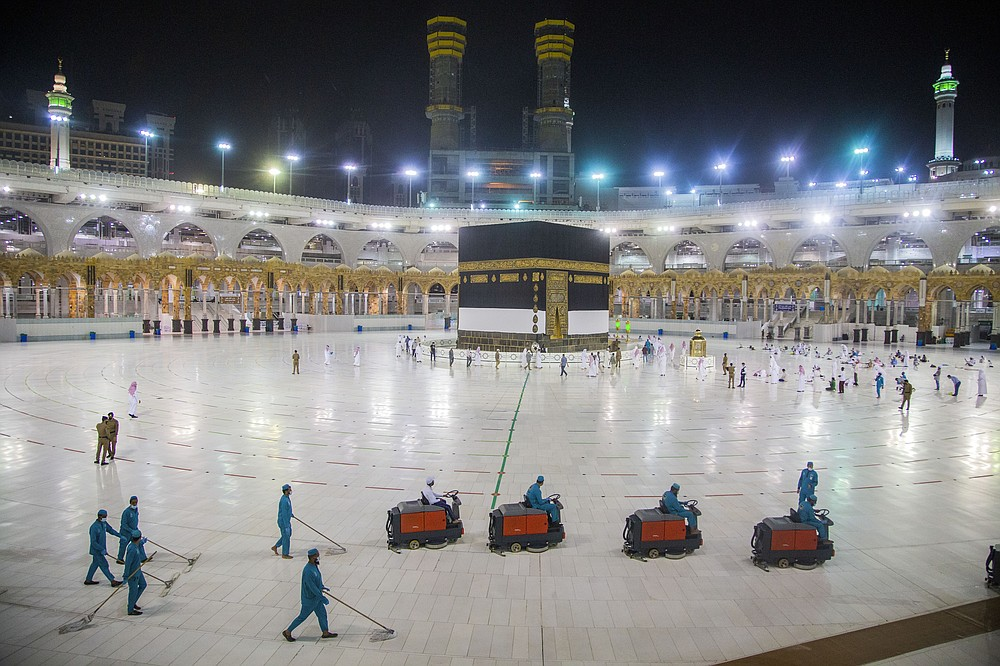 The area around the Kaaba is prepared for pilgrims, in Mecca, Saudi Arabia, Monday, July 27, 2020. Only about 1,000 pilgrims will be allowed to perform the annual hajj pilgrimage this year due to the virus pandemic. (Saudi Ministry of Media via AP)