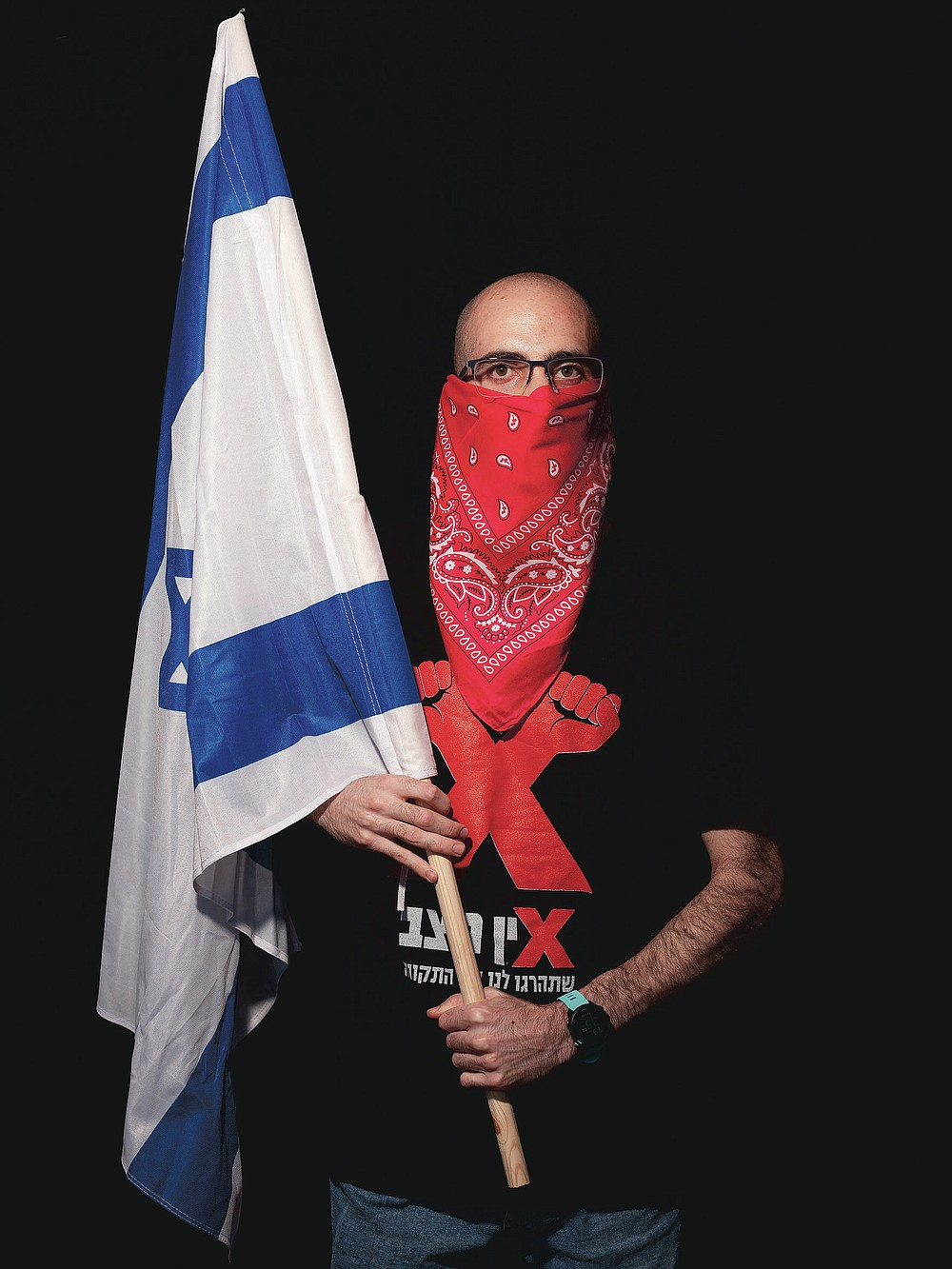 Dekel Gilag, 25, poses for a photo during a protest against Israel's Prime Minister Benjamin Netanyahu, outside his residence in Jerusalem, Thursday, July 23, 2020. The wave of colorful and combative demonstrations against Netanyahu and his perceived failure to handle the country's deepening economic crisis have been characterized by youth. With flags, facemasks, drums, placards and an assortment of props, thousands have been taking to the streets to demand change in a variety of unique ways. (AP Photo/Oded Balilty)