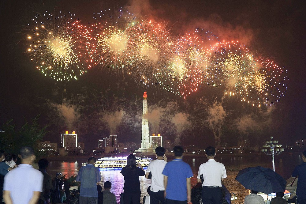 People watch fireworks exploded in Pyongyang, North Korea, Monday, July 27, 2020, marking the 67th anniversary of the end of the 1950-53 Korean War. (Kyodo News via AP)