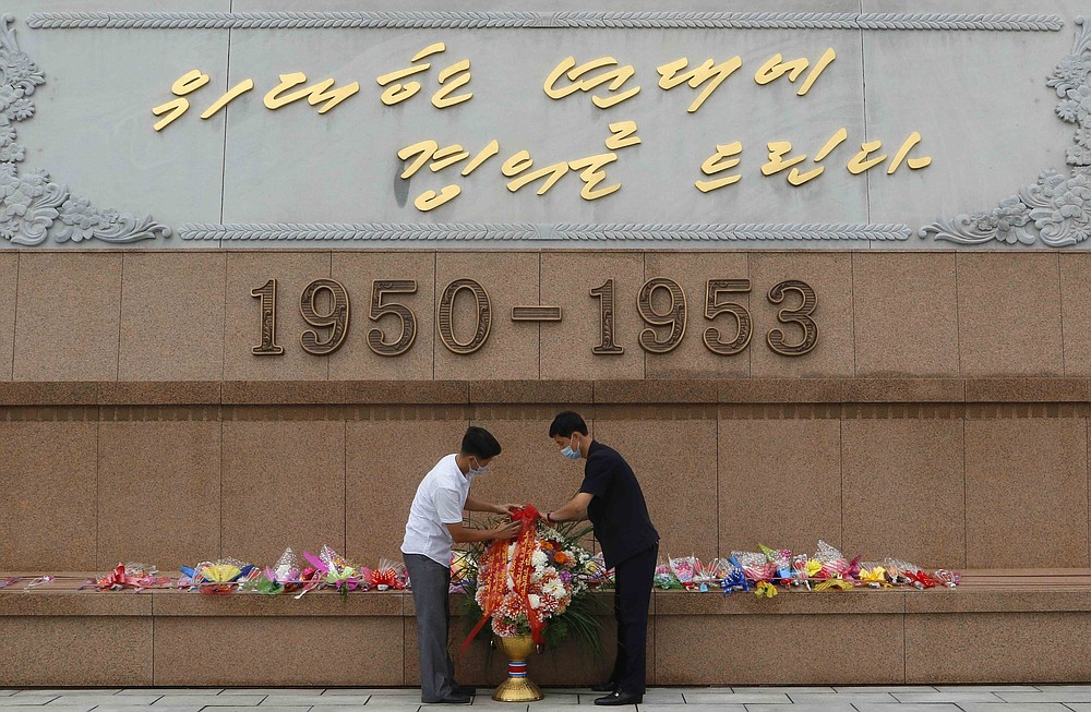 """People visit the Victorious Fatherland Liberation War Museum to lay flowers on the occasion of the 67th anniversary of the end of the Korean War, which the country celebrates as the day of """"victory in the fatherland liberation war"""" in Pyongyang, Monday, July 27, 2020. (AP Photo/Jon Chol Jin)"""