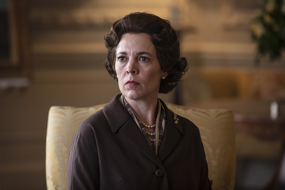 "In this image released by Netflix, Olivia Colman portrays Queen Elizabeth II in a scene from ""The Crown."" Colman was nominated for an Emmy Award for outstanding lead actress in a drama series on Tuesday, July 28, 2020. (Sophie Mutevelian/Netflix via AP)"