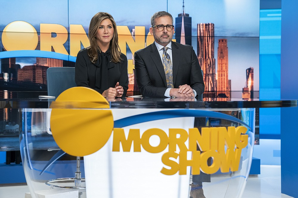 "This image released by Apple TV Plus shows Jennifer Aniston, left, and Steve Carell in a scene from ""The Morning Show."" Nominations for the  Emmy Awards will be announced on Tuesday, July 28. (Hilary B. Gayle/Apple TV Plus via AP)"
