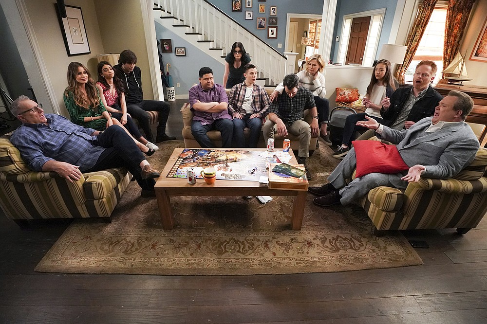 "This image released by ABC shows the cast of ""Modern Family,"" from left, Ed O'Neill, Sofia Vergara, Sarah Hyland, Reid Ewing, Rico Rodriguez, Ariel Winter, Nolan Gould, Ty Burrell, Julie Bowen, Aubrey Anderson-Emmons, Jesse Tyler Ferguson and Eric Stonestreet. The program, which ended this season, was not nominated for an Emmy Award for outstanding comedy series on Tuesday, July 28, 2020.  (Eric McCandless/ABC via AP)"