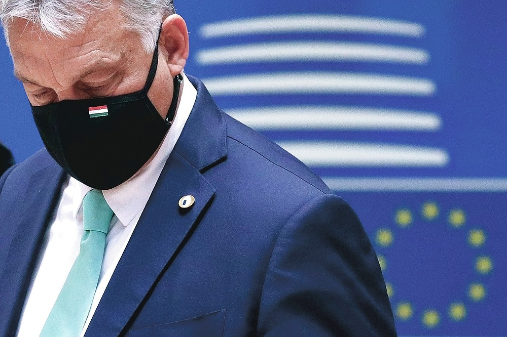 Hungary's Prime Minister Viktor Orban wears a protective face mask as he arrives for a round table meeting at an EU summit in Brussels on July 18, 2020. (Francois Lenoir, Pool Photo via AP)