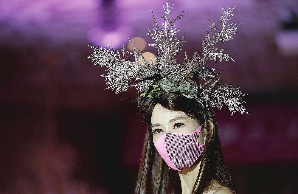 A model wears a face mask during a mask fashion show in Seoul, South Korea on July 24, 2020. (AP Photo/Lee Jin-man)