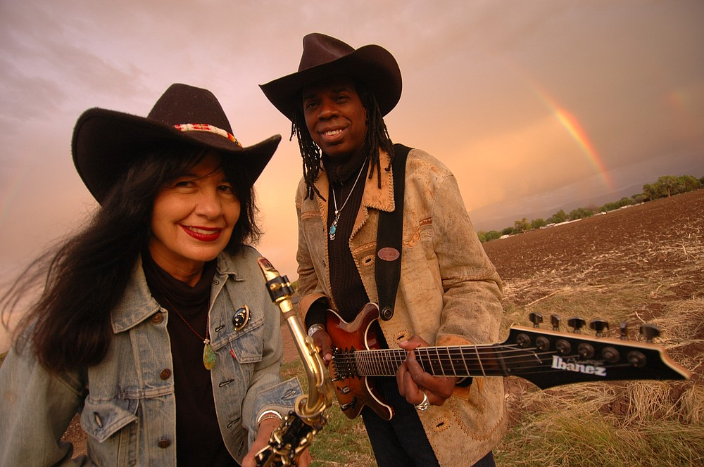 Fayetteville theater company TheatreSquared will live-stream a concert Saturday by U.S. Poet Laureate Joy Harjo (left) and Grammy Award-winning guitarist Larry Mitchell (with blues-folk musician Katie Martin).  (Special to the Democrat-Gazette)