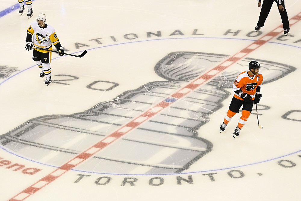 Pittsburgh Penguins center Sidney Crosby (87) and Philadelphia Flyers center Claude Giroux (28) get ready to face-off  before an exhibition NHL hockey game, Tuesday, July 28, 2020 in Toronto. (Nathan Denette/The Canadian Press via AP)