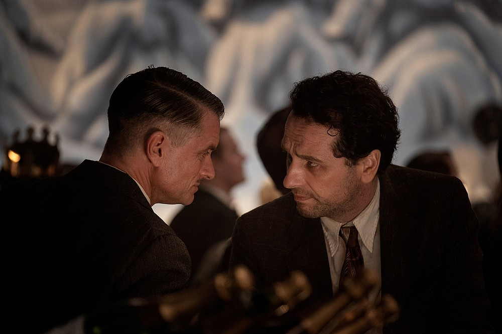 "Pete Strickland (left, Shea Whigham) and Perry Mason (Matthew Rhys) confer in HBO's ""Perry Mason."""