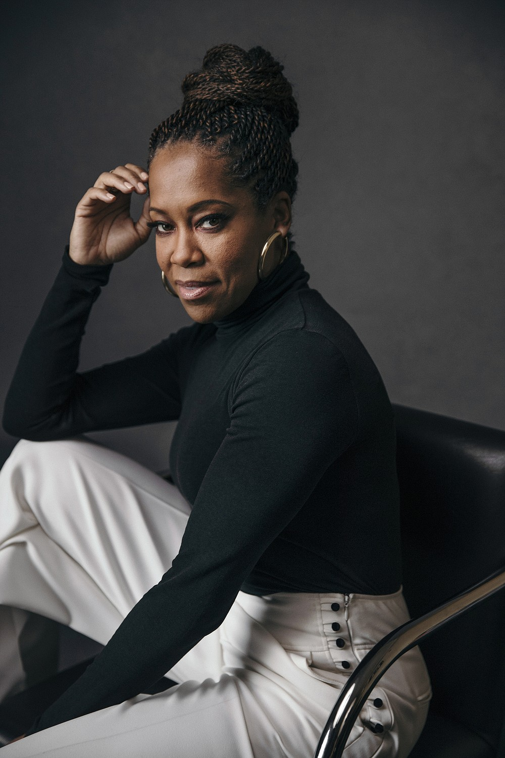 """FILE - Regina King poses for a portrait at Sofitel in New York on Feb. 13, 2019. The Toronto International Film Festival on Thursday unveiled a lineup featuring King's directorial debut """"One Night in Miami,  a drama about a young Muhammad Ali, then Cassius Clay. The festival, which is set to run Sept. 10-19, has plotted a largely virtual 45th edition due to the pandemic. (Photo by Victoria Will/Invision/AP, File)"""