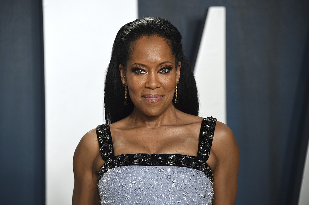 """FILE - Regina King arrives at the Vanity Fair Oscar Party in Beverly Hills, Calif. on Feb. 9, 2020. The Toronto International Film Festival on Thursday unveiled a lineup featuring King's directorial debut """"One Night in Miami,  a drama about a young Muhammad Ali, then Cassius Clay. The festival, which is set to run Sept. 10-19, has plotted a largely virtual 45th edition due to the pandemic. (Photo by Evan Agostini/Invision/AP, File)"""