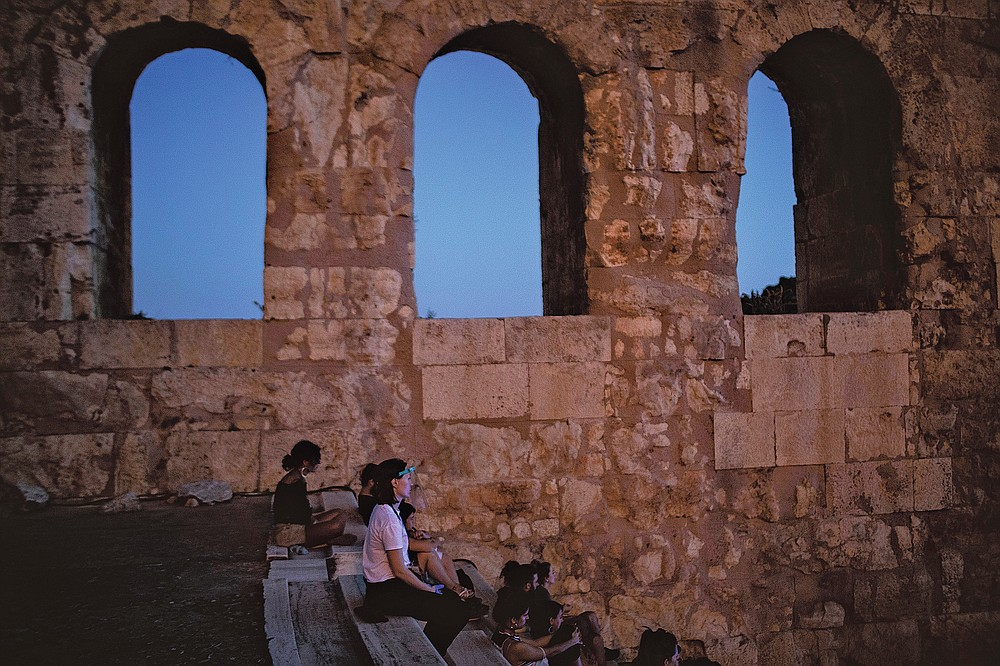 Spectators enjoy a performance at Herodes Atticus in Athens, after the site was reopened on Wednesday, July 15, 2020. Greece opened it's ancient theaters as the country easing coronavirus lockdown measures.(AP Photo/Petros Giannakouris)