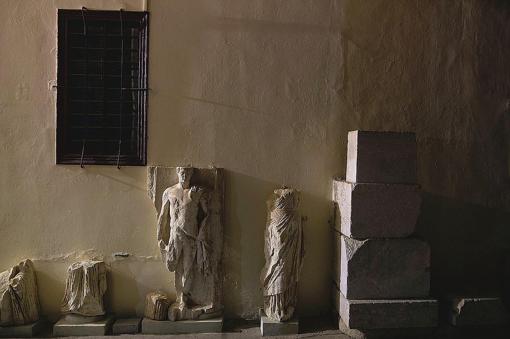 Ancient marble statues are seen outside the Archaeological Museum of Epidaurus next the ancient theatre of the site, early Saturday, July 186, 2020. Greek Culture Ministry allowed the ancient theaters of Epidaurus in southern Greece and Herodes Atticus in Athens to host performances under strict safety guidelines due the COVID-19 pandemic.(AP Photo/Petros Giannakouris)