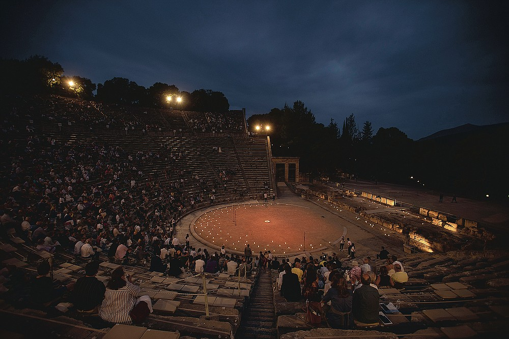 Spectators sit at the ancient theater of Epidaurus, during a concert, on Friday, July 17, 2020. Greek Culture Ministry allowed the ancient theaters of Epidaurus in southern Greece and Herodes Atticus in Athens to host performances under strict safety guidelines due the COVID-19 pandemic.(AP Photo/Petros Giannakouris)