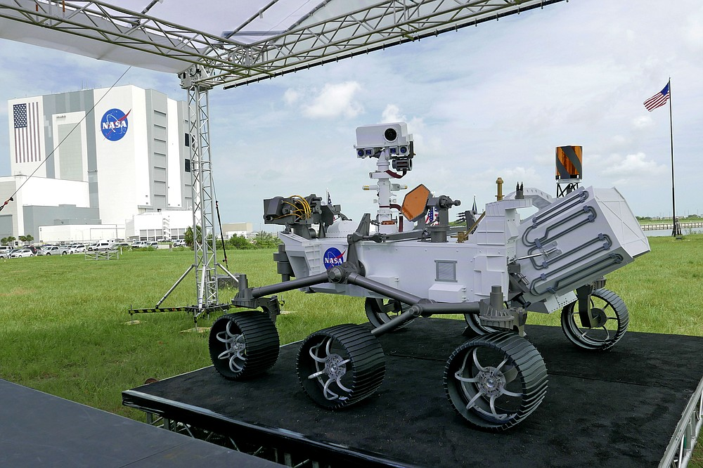 A replica of the Mars rover Perseverance is displayed outside the press site before a news conference at the Kennedy Space Center Wednesday, July 29, 2020, in Cape Canaveral, Fla. United Launch Alliance Atlas V rocket launch scheduled for tomorrow will transport the rover to Mars. (AP Photo/John Raoux)