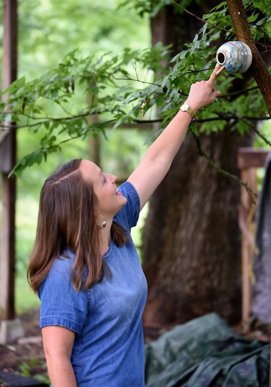 Meredith Bergstrom describes a wren house Thursday, July 9, 2020, in her backyard of her Siloam Springs home. With the pandemic Bergstrom has had the opportunity to spend more time pursuing her bird watching hobby. Check out nwaonline.com/200723Daily/ and nwadg.com/photos for a photo gallery. (NWA Democrat-Gazette/David Gottschalk)