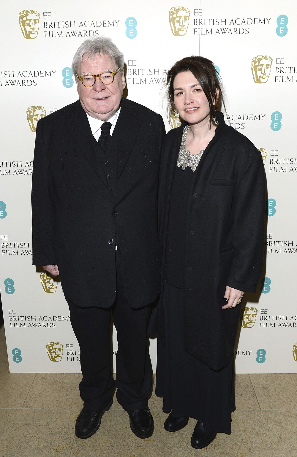 "FILE - Director Alan Parker and his wife, Lisa arrive for the BAFTA Film Awards in London on Feb. 10, 2013. Parker, whose movies included ""Bugsy Malone,"" ""Midnight Express"" and ""Evita,"" has died at the age of 76. A statement from the director's family says Parker died Friday in London after a long illness. (Photo by Jon Furniss/Invision/AP, File)"
