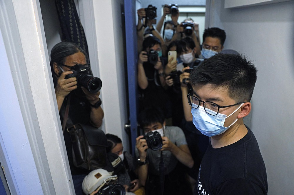 Hong Kong pro-democracy activist Joshua Wong attends a press conference in Hong Kong, Friday, July 31, 2020. On Thursday, 12 pro-democracy candidates including prominent pro-democracy activist Joshua Wong were disqualified from running in the legislative elections, as they were deemed to not comply with the Basic Law or pledge allegiance to the city and Beijing. (AP Photo/Kin Cheung)