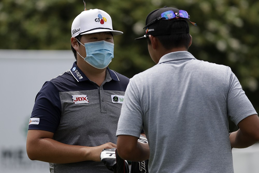 Sungjae Im. Of South Korea, wears a face masks as he chats with a fellow golfer after the second round of the World Golf Championship-FedEx St. Jude Invitational Friday, July 31, 2020, in Memphis, Tenn. (AP Photo/Mark Humphrey)