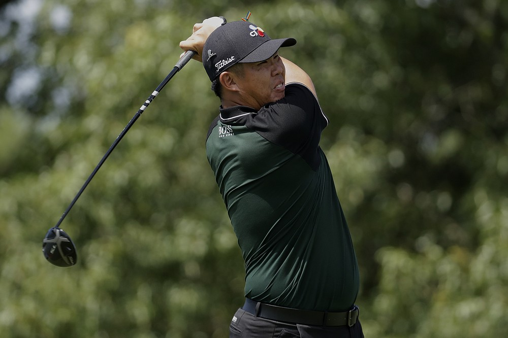 Byeong Hun An of South Korea, watches his tee shot on the ninth hole during the second round of the World Golf Championship-FedEx St. Jude Invitational Friday, July 31, 2020, in Memphis, Tenn. (AP Photo/Mark Humphrey)