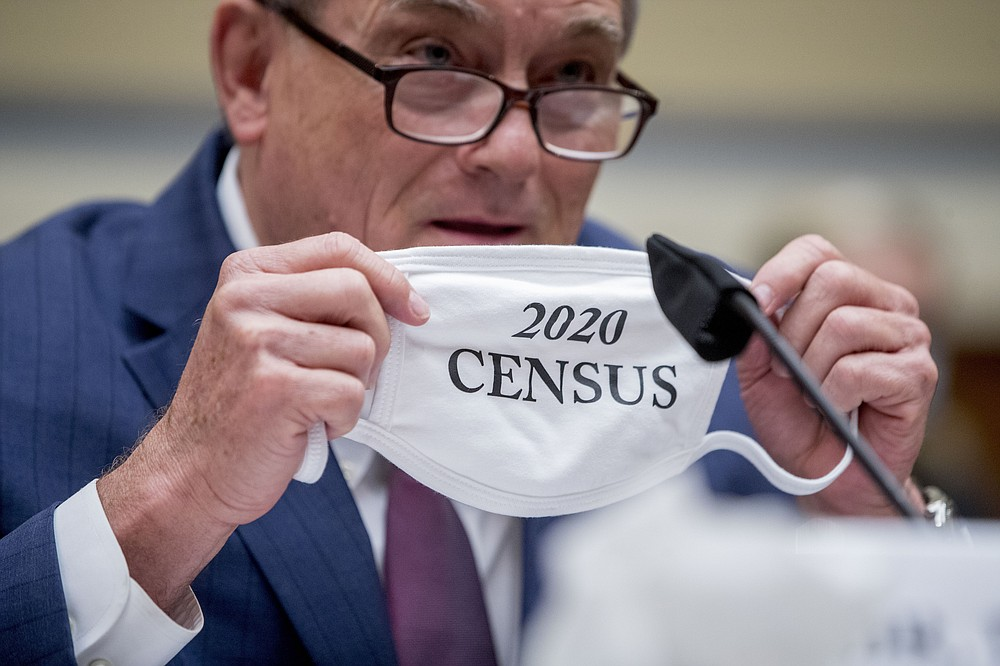 "Census Bureau Director Steven Dillingham holds up his mask with the words ""2020 Census"" as he testifies before a House Committee on Oversight and Reform hearing on the 2020 Census​ on Capitol Hill, Wednesday, July 29, 2020, in Washington. (AP Photo/Andrew Harnik)"