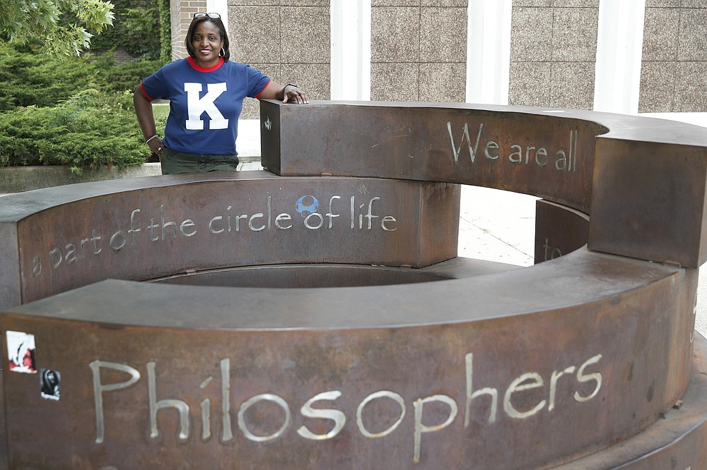 Karen Calloway, principal of Kenwood Academy in Chicago, poses Tuesday, July 28, 2020, for a portrait by the school's Inspirational Circle, designed by Kenwood students in 2003, in the Hyde Park neighborhood campus. School districts around the U.S. are working to remove police officers from campuses, but the school council for Kenwood Academy, a predominantly Black school near the University of Chicago, recently unanimously voted to keep its officer. (AP Photo/Charles Rex Arbogast)