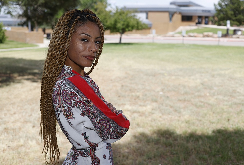 Tiera Brown stands outside Montbello High School in northeast Denver on June 22, 2020 Former Denver student Brown, 28, wonders if there would be more fellow Black students in her University of Denver law class if they had been treated with more understanding earlier in their educations. (AP Photo/David Zalubowski)