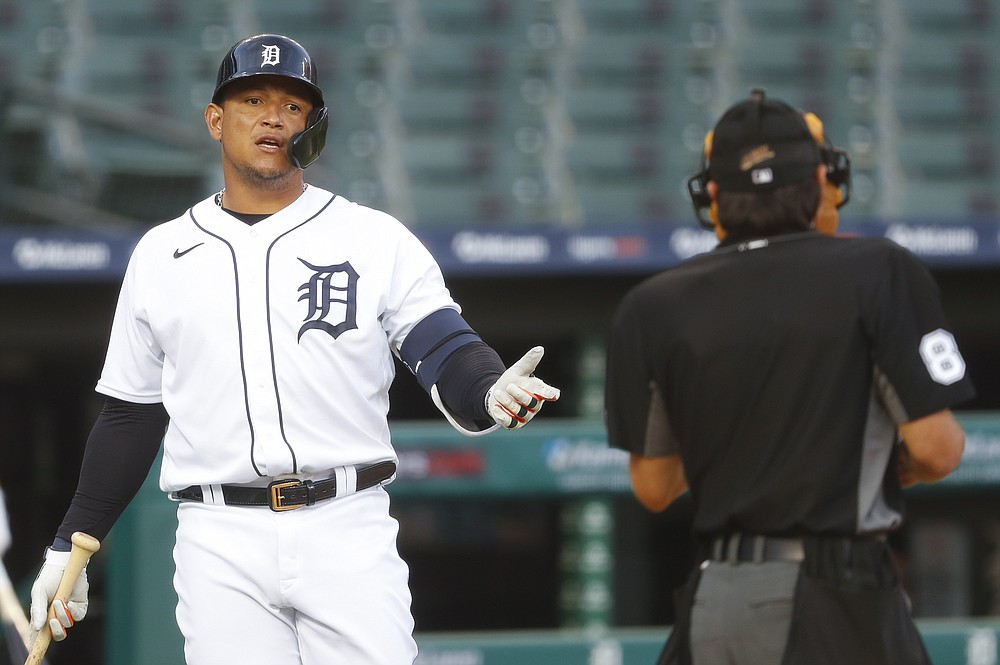 Detroit Tigers' Miguel Cabrera talks with home plate umpire David Rackley after striking out against the Cincinnati Reds in the fourth inning of a baseball game in Detroit, Friday, July 31, 2020. (AP Photo/Paul Sancya)